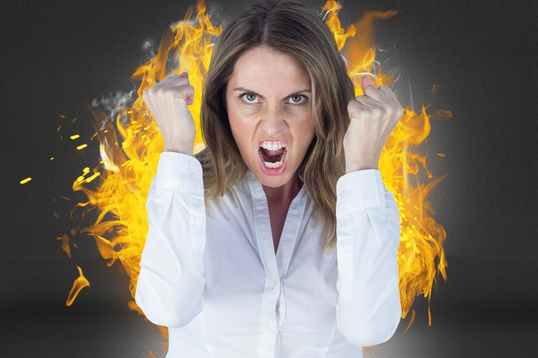 Digital composite of Digital composite image of angry businesswoman clenching fists against fire