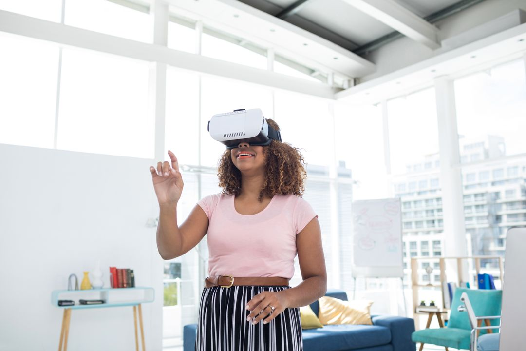 Female executive using virtual reality headset in the office
