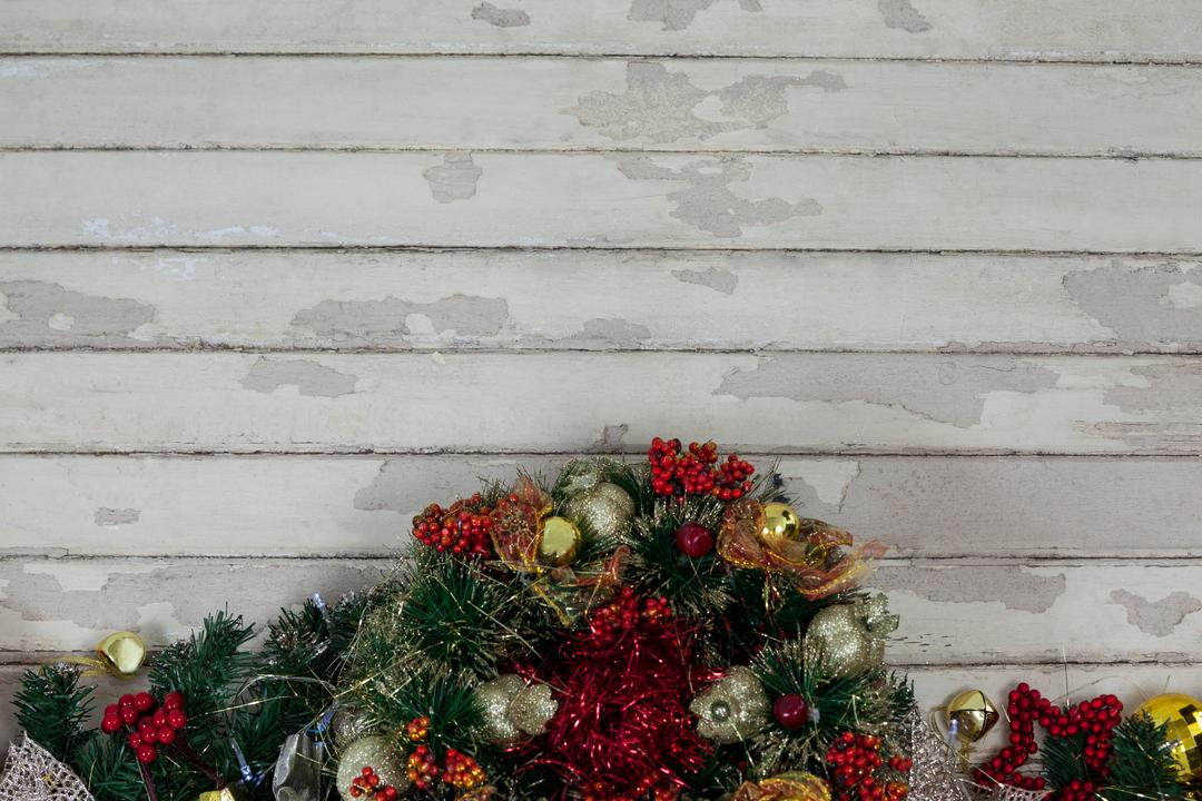 Fir with christmas decoration on a plank