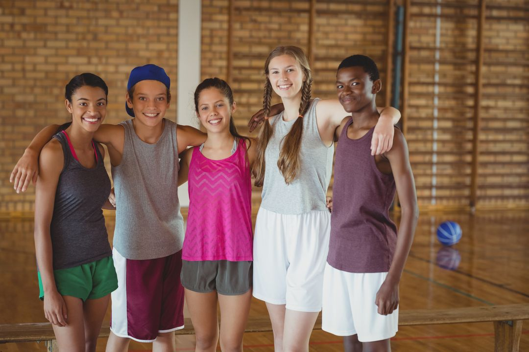 Portrait of high school kids standing together in basketball court Free Stock Images from PikWizard