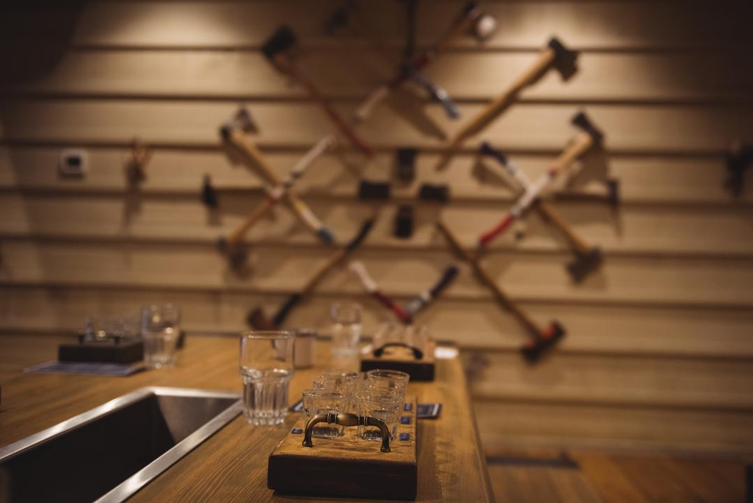 Wooden beer tray with glasses on bar counter