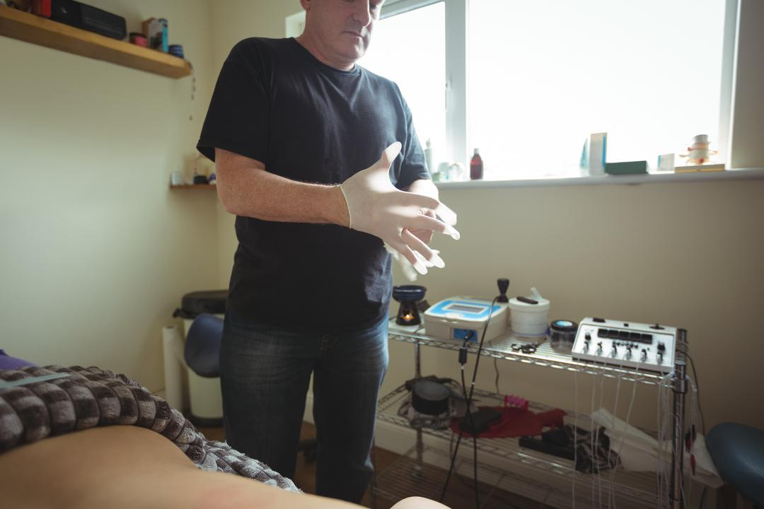 Therapist wearing protective gloves in spa