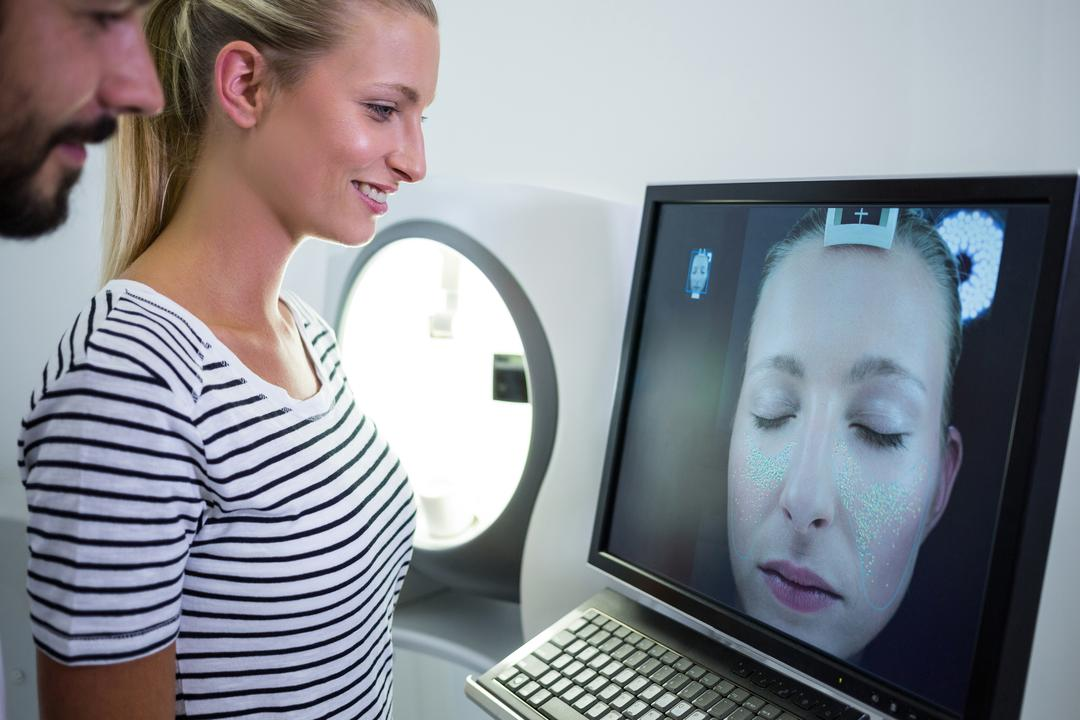 Woman looking mri scan report on computer screen in clinic Free Stock Images from PikWizard