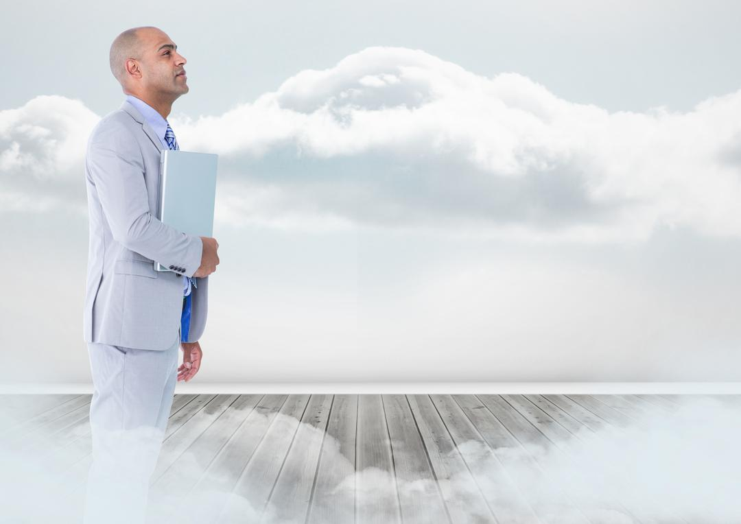 Digital composite of Businessman with laptop standing on floor in clouds