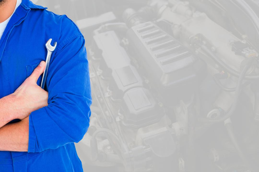 Digital composite of Midsection of mechanic holding wrench