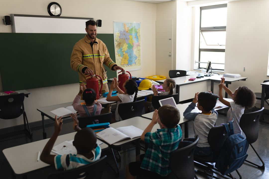 Front view of a schoolkids applauding while male Caucasian firefighter teaching about fire safety in classroom of elementary school Free Stock Images from PikWizard