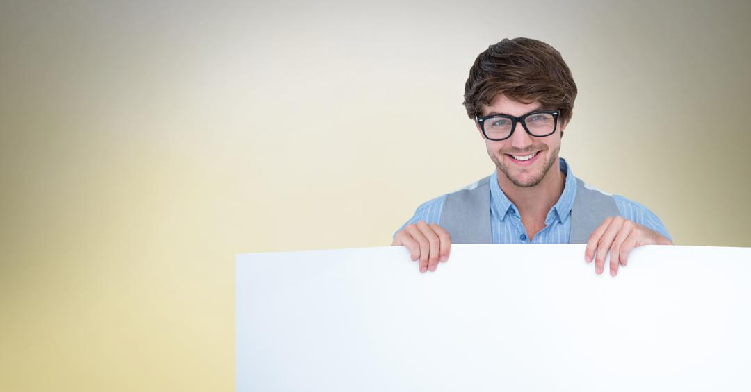 Digital composite of Man wearing eyeglasses while holding blank bill board Free Stock Images from PikWizard