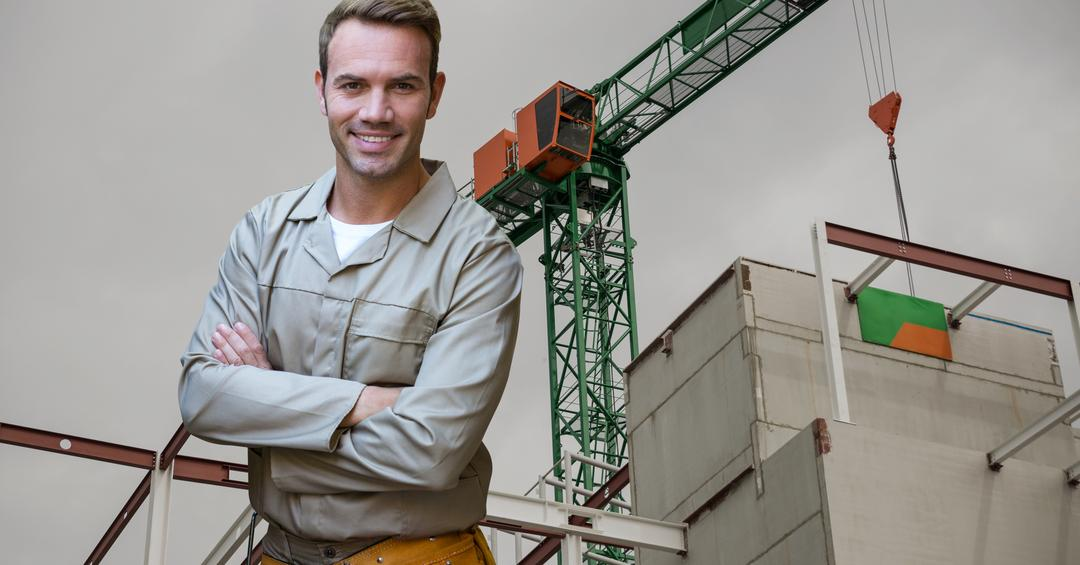 Digital composite image of handyman standing with arms crossed against construction site Free Stock Images from PikWizard