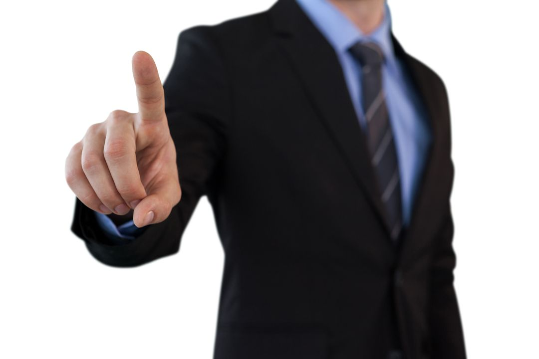 Mid section of businessman touching index finger on invisible screen while standing against white background Free Stock Images from PikWizard
