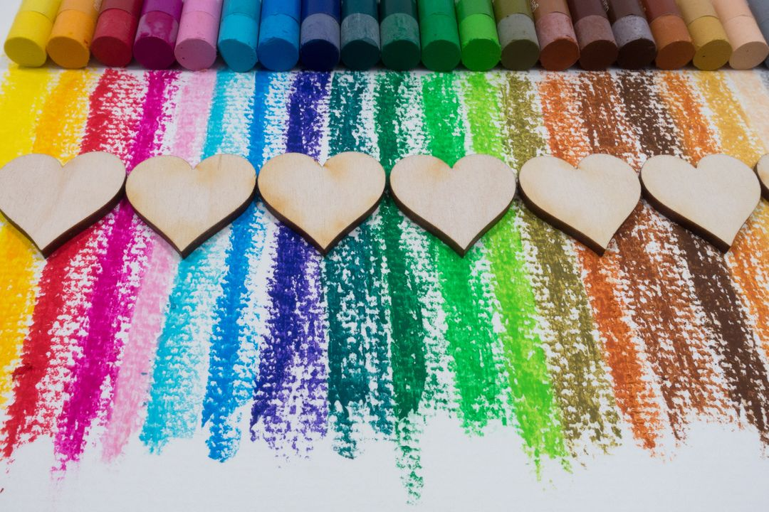 Image of colorful crayons with wooden hearts