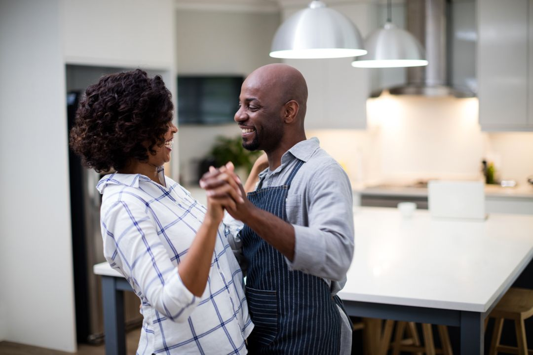 Romantic couple dancing in kitchen at home Free Stock Images from PikWizard
