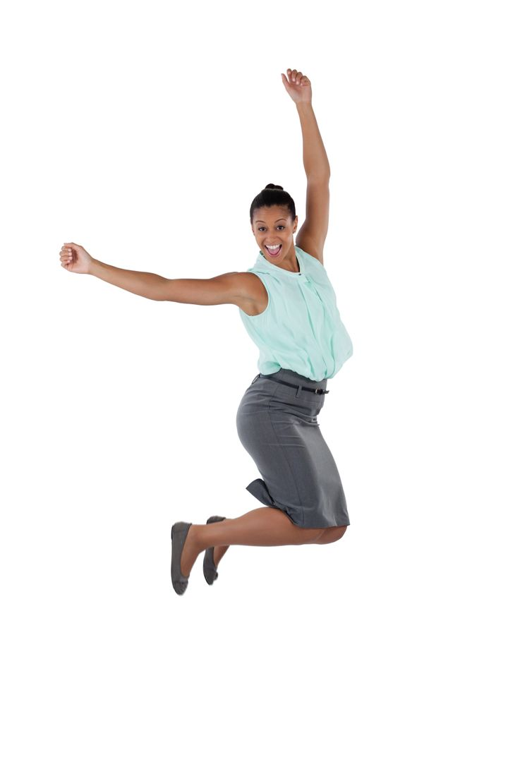 Excited businesswoman jumping in the air against white background Free Stock Images from PikWizard