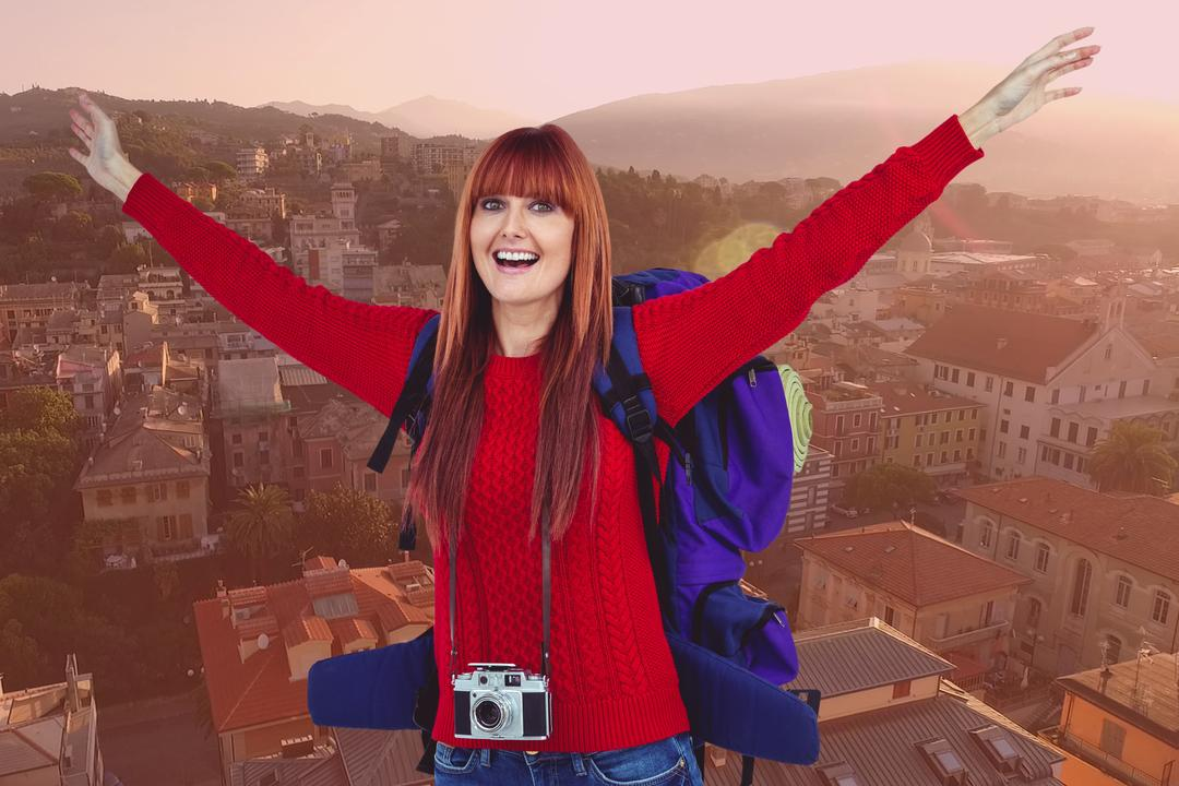 Digital composite of Portrait of cheerful female tourist with buildings in background
