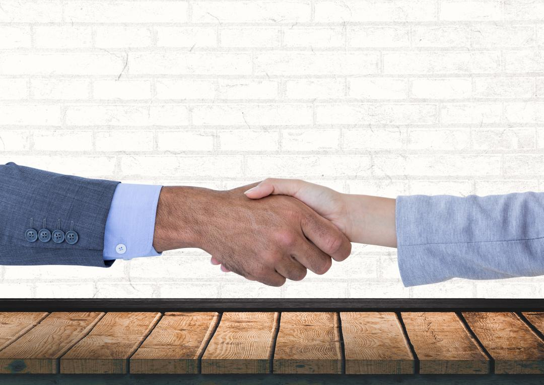Digital composite of Business handshake against wall