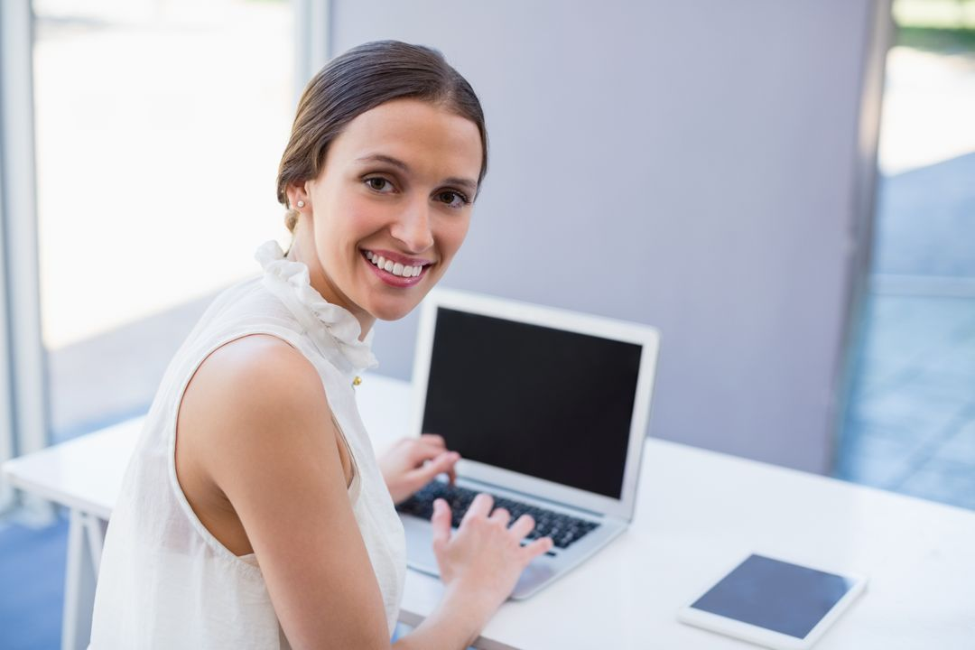 Portrait of a beautiful woman using laptop at conference centre Free Stock Images from PikWizard