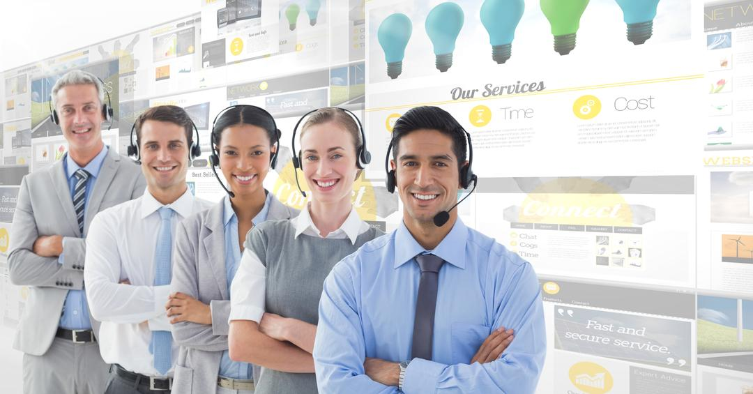 Portrait of call center executives in headset standing with arms crossed in office