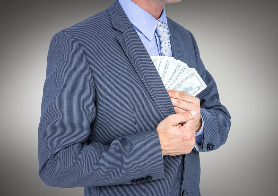 Digital composite of Business man mid section putting money away against grey background