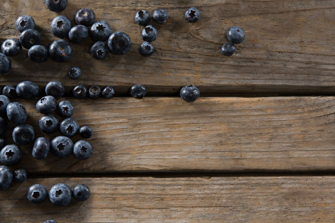 Overhead of blueberries on wooden table Free Stock Images from PikWizard