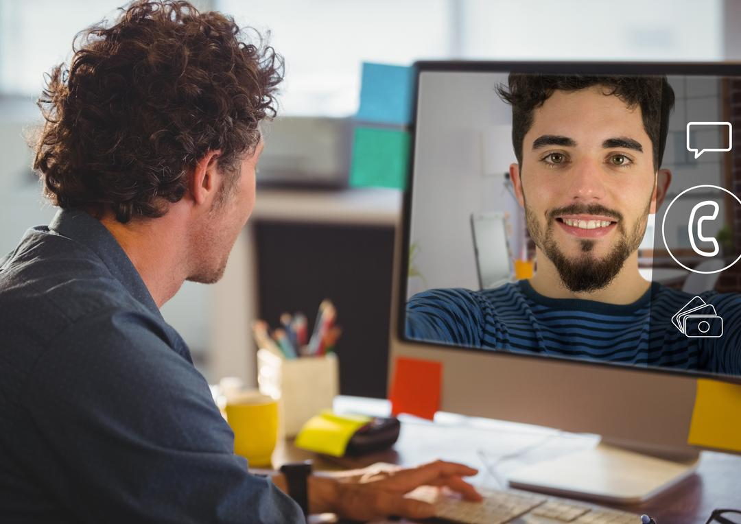 Man having a video chat on computer screen at office