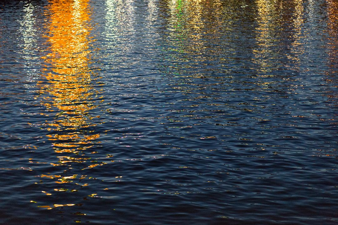 Sunset water reflections golden