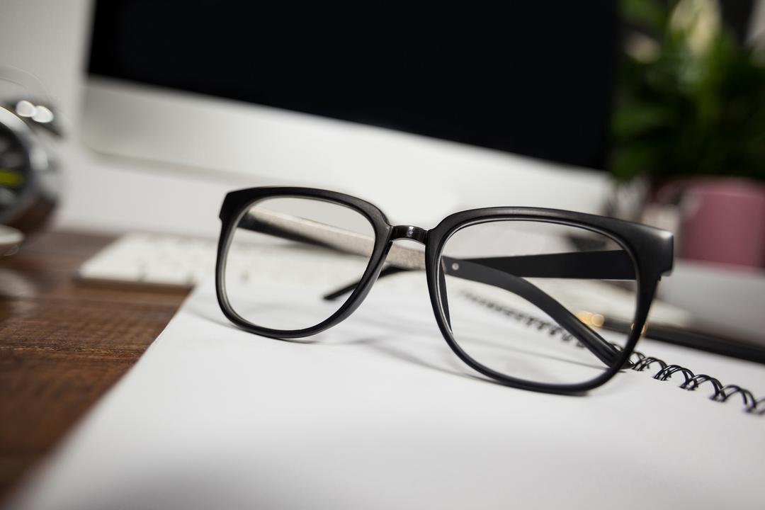 Close- up of reading glasses on office desk in the office