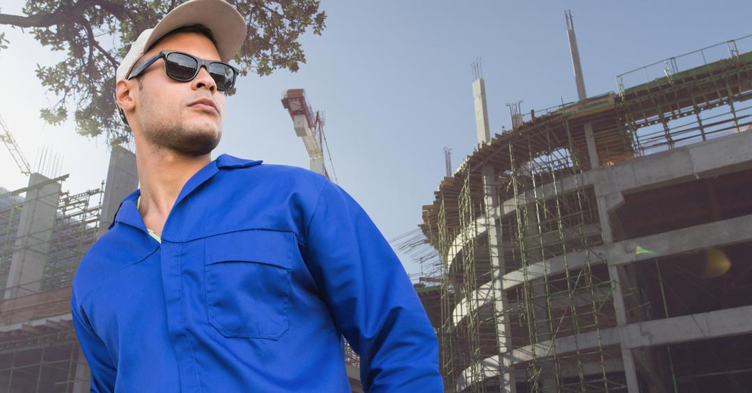 Smart worker standing at construction site during day