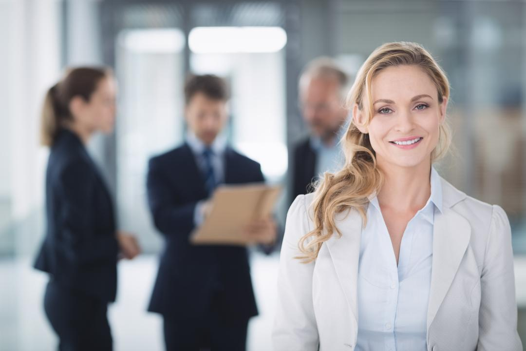 Portrait of a confident businesswoman smiling inside office Free Stock Images from PikWizard