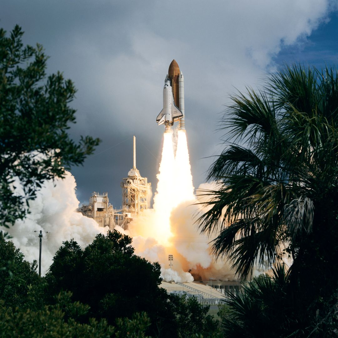 STS057-S-055 (21 June 1993) --- Framed by a variety of flora types, the Space Shuttle Endeavour lifts off Launch Pad 39B to begin the STS-57 mission.  Launch occurred at 9:07:22 a.m. (EDT), June 21, 1993.  The mission represents the first flight of the commercially developed SPACEHAB laboratory module and also will feature a retrieval of the European Retrievable Carrier (EURECA).  Onboard for Endeavour's fourth flight are a crew of six - Ronald J. Grabe, mission commander; Brian Duffy, pilot; G. David Low, payload commander; and Nancy J. Sherlock, Peter J.K. (Jeff) Wisoff and Janice E. Voss, all mission specialists.  An earlier launch attempt was scrubbed due to unacceptable weather conditions both at KSC and the overseas contingency landing sites.