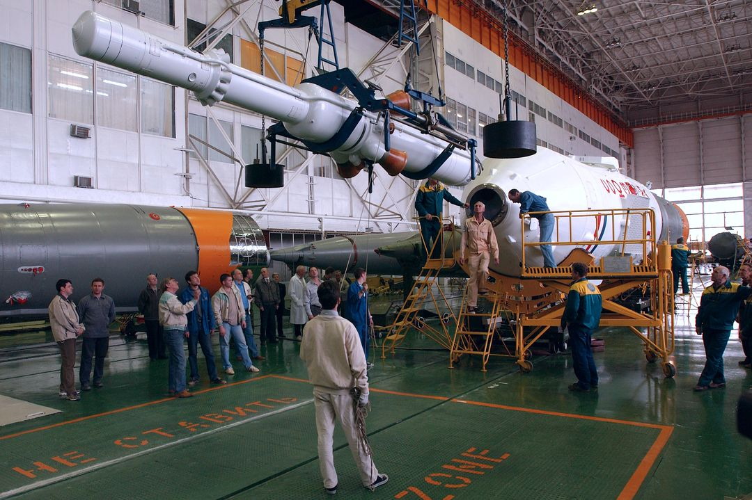 Engineers at the Baikonur Cosmodrome prepare to mate the Soyuz TMA-4 capsule with its booster rocket in preparation for a launch on April 19 of the Expedition 9 crew and a European astronaut to the International Space Station, Friday, April 16, 2004 in Baikonur, Kazakhstan.  Photo Credit: (NASA/Bill Ingalls)