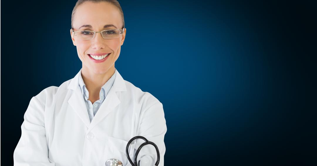 Portrait of a happy female doctor standing against blue background