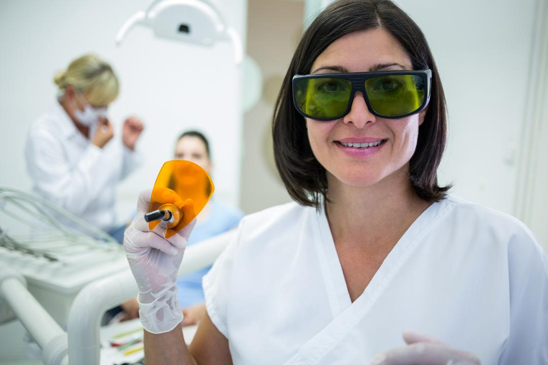 Dentist holding a dental curing ultraviolet light at clinic