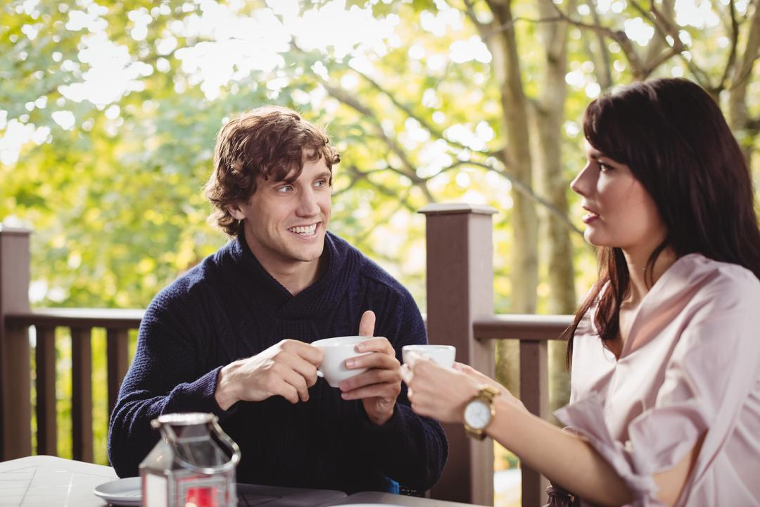 Couple having coffee together in restaurant