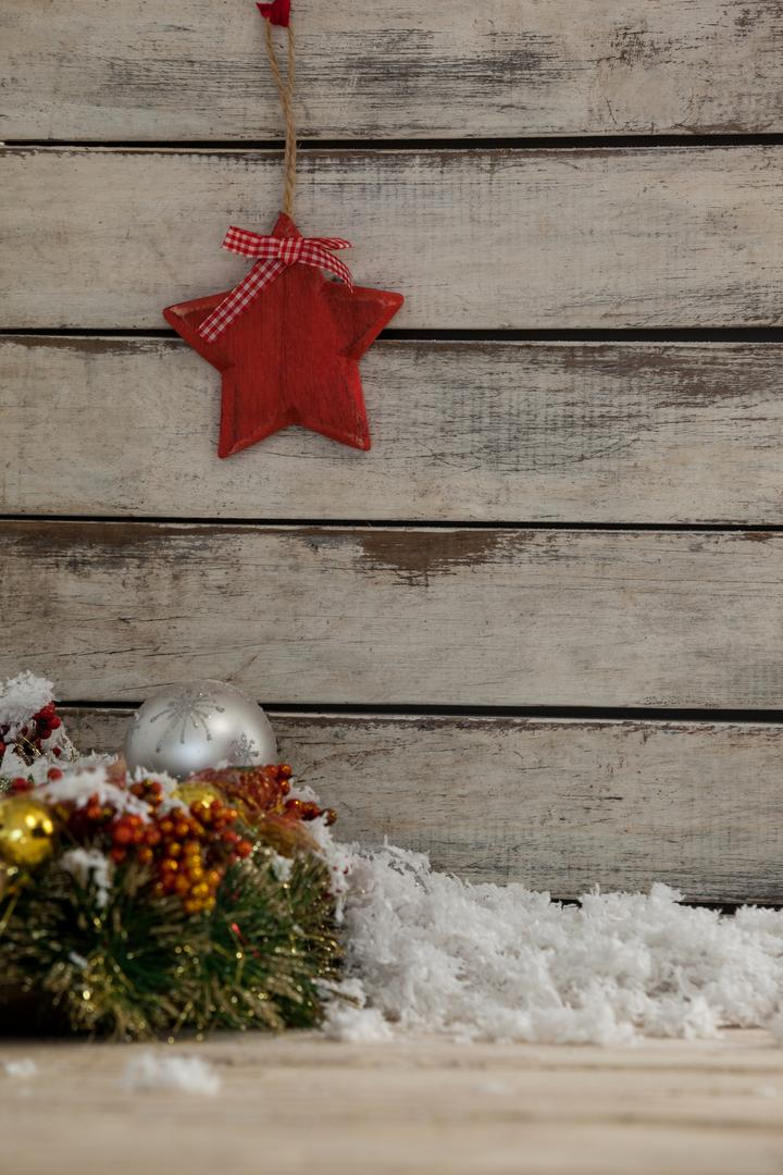 Star shape decoration hanging with fir and christmas decoration