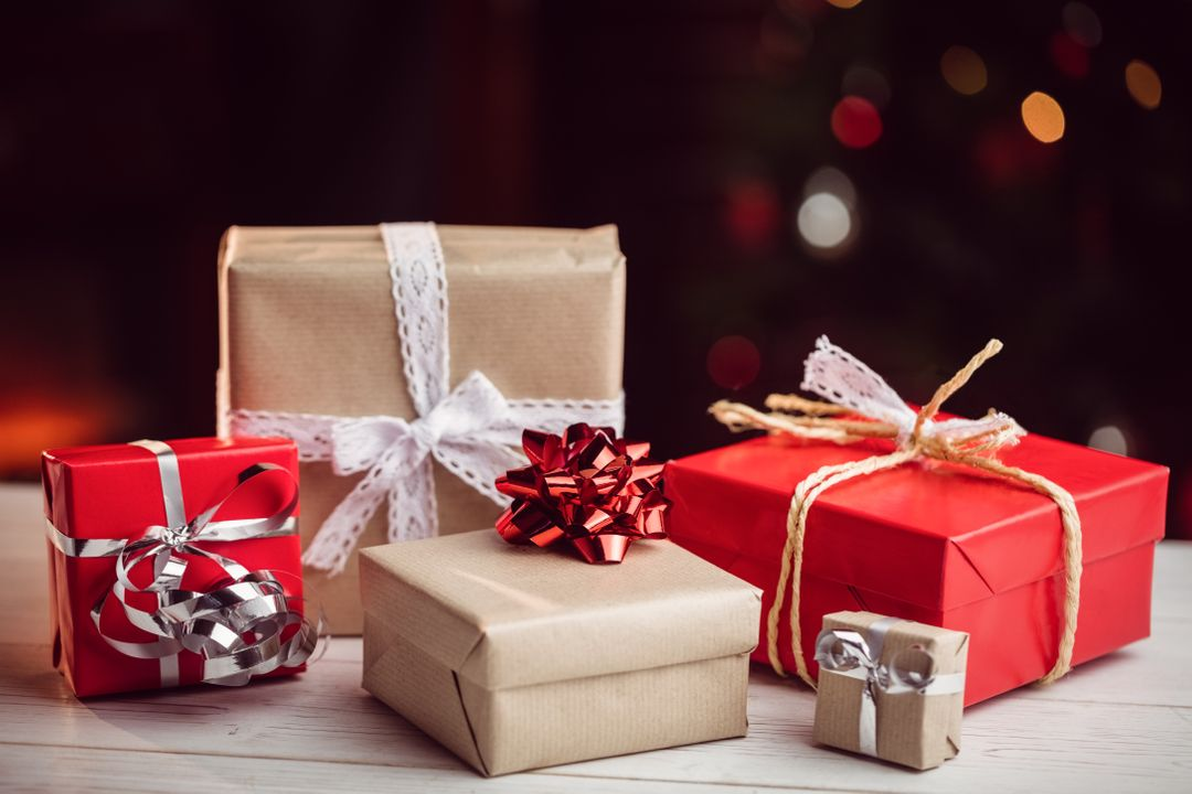 Composite image of presents on a table in black background