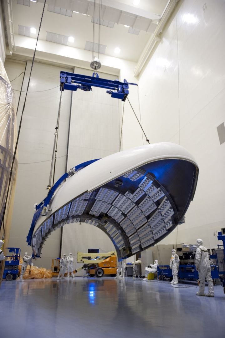 CAPE CANAVERAL, Fla. -- In the Payload Hazardous Servicing Facility at NASA's Kennedy Space Center in Florida, the fairing acoustic protection (FAP) system lining the inside of the Atlas V payload fairing for NASA's Mars Science Laboratory (MSL) mission comes into view as the fairing is lifted into a vertical position.  The FAP protects the payload by dampening the sound created by the rocket during liftoff.  The fairing has been uncovered, and preparations are under way to clean it to meet NASA's planetary protection requirements.    The fairing will protect the spacecraft from the impact of aerodynamic pressure and heating during ascent.  Although jettisoned once the spacecraft is outside the Earth's atmosphere, the fairing must be cleaned to the same exacting standards as the laboratory to avoid the possibility of contaminating it. MSL's components include a compact car-sized rover, Curiosity, which has 10 science instruments designed to search for evidence on whether Mars has had environments favorable to microbial life, including the chemical ingredients for life. The unique rover will use a laser to look inside rocks and release its gasses so that the rover's spectrometer can analyze and send the data back to Earth. Launch of MSL aboard a United Launch Alliance Atlas V rocket is planned for Nov. 25 from Space Launch Complex 41 on Cape Canaveral Air Force Station. For more information, visit http://www.nasa.gov/msl. Photo credit: NASA/Kim Shiflett