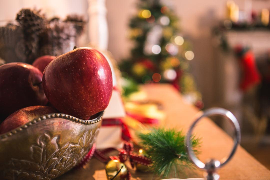 Fruit bowl and christmas decoration on wooden table
