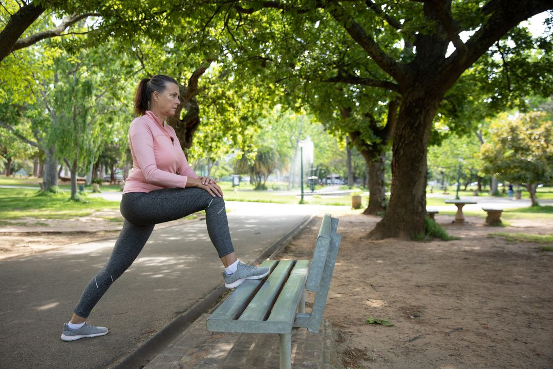 Senior Caucasian woman working out in the park wearing sports clothes, stretching her legs on a bench. Retirement healthy lifestyle activity. Free Stock Images from PikWizard