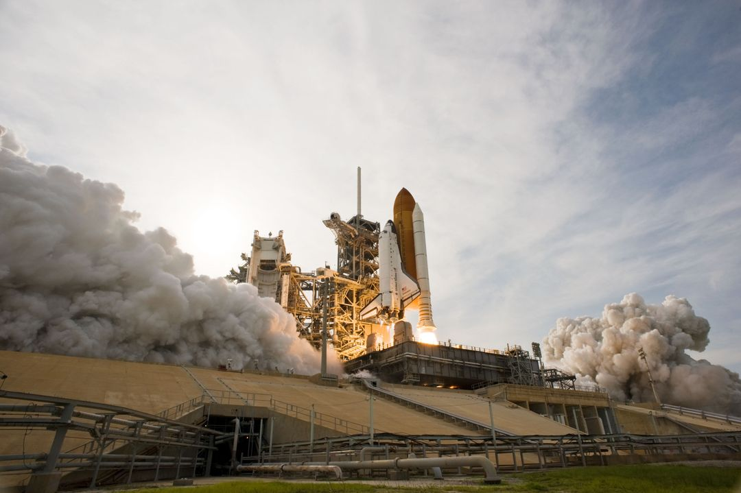 STS127-S-037 (15 July 2009) --- Space Shuttle Endeavour and its seven-member STS-127 crew head toward Earth orbit and rendezvous with the International Space Station. Liftoff was on time at 6:03 p.m. (EDT) on July 15, 2009 from launch pad 39A at NASA?s Kennedy Space Center. Onboard are astronauts Mark Polansky, commander; Doug Hurley, pilot; Christopher Cassidy, Tom Marshburn, Dave Wolf, Tim Kopra and Canadian Space Agency?s Julie Payette, all mission specialists. Kopra will join Expedition 20 in progress to serve as a flight engineer aboard the ISS. Endeavour will deliver the Japanese Experiment Module's Exposed Facility and the Experiment Logistics Module-Exposed Section in the final of three flights dedicated to the assembly of the Japan Aerospace Exploration Agency's Kibo laboratory complex on the space station.