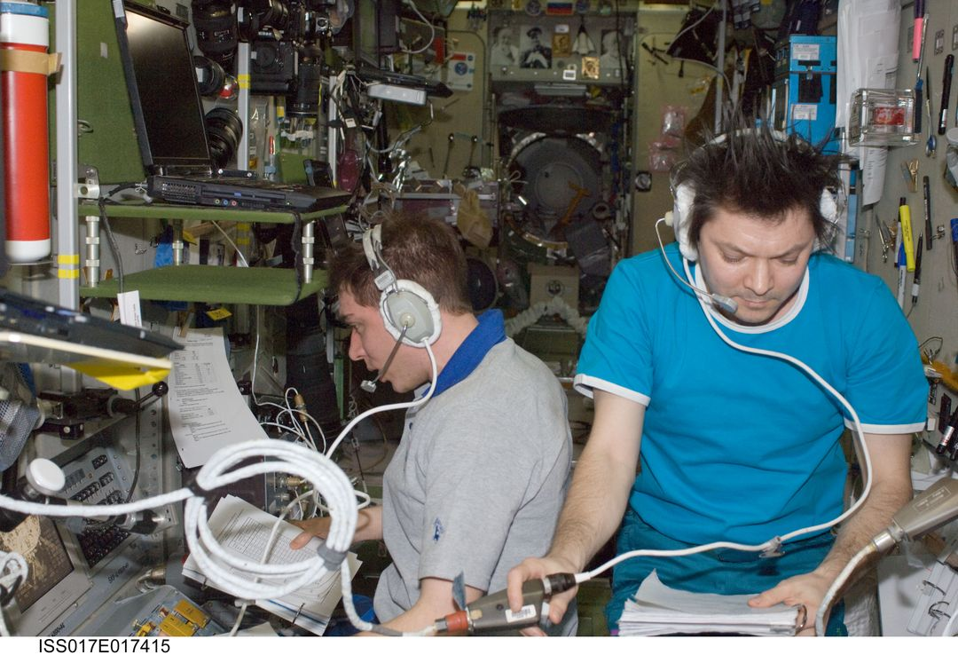 ISS017-E-017415 (17 Sept. 2008) --- Russian Federal Space Agency cosmonauts Sergei Volkov (left) and Oleg Kononenko, Expedition 17 commander and flight engineer, respectively, monitor data at the manual TORU docking system controls in the Zvezda Service Module of the International Space Station during the docking of the unpiloted Progress 30 supply vehicle. The Progress used the automated Kurs system to dock to Zvezda's aft port on Sept. 17.