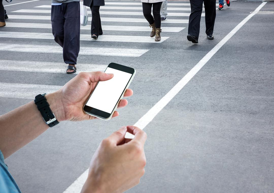 Digital composite of Men hands with phone in a crosswalk