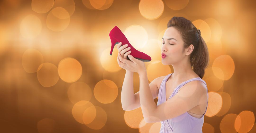 Digital composite of Young woman kissing heels over blured background