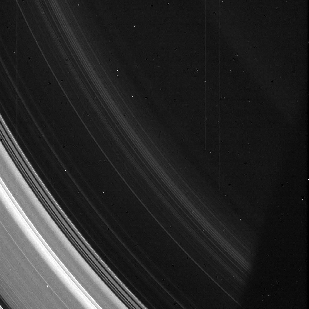 In this image from NASA Cassini spacecraft, the spiral structures in the D ring are on display, although it is so thin as to be barely noticeable compared to the rest of the ring system.