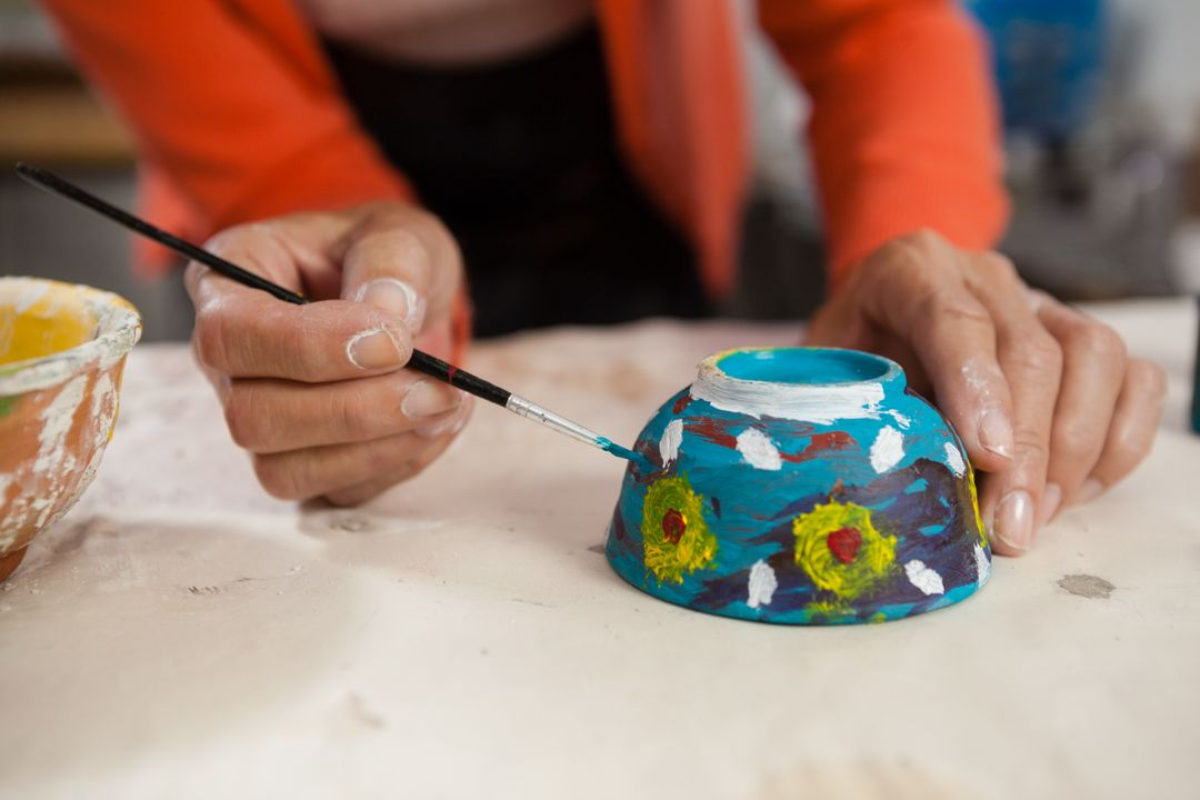 Mid section of woman painting bowl in class Free Stock Images from PikWizard