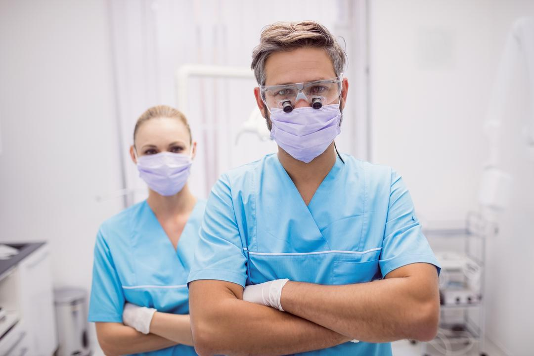 Portrait of dentist standing with arms crossed at dental clinic
