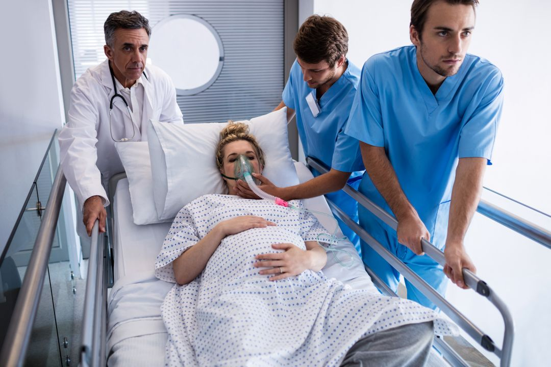 Team of doctors taking pregnant woman to operation theatre in the hospital Free Stock Images from PikWizard