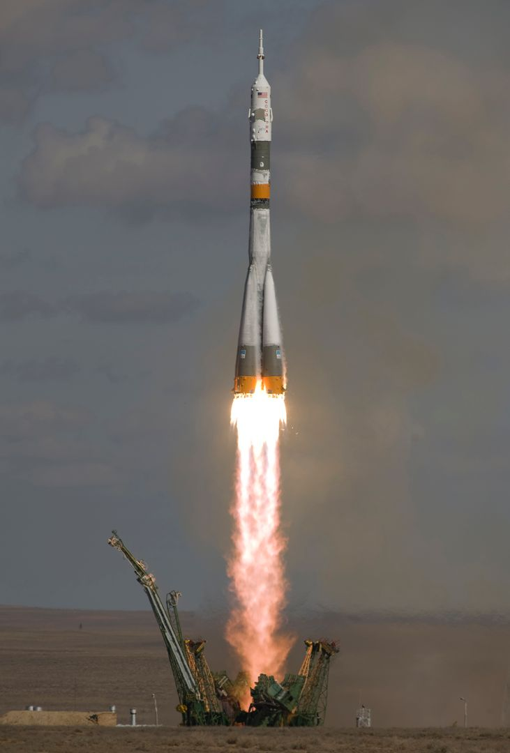 The Soyuz TMA-13 spacecraft, carrying Expedition 18 Commander Michael Fincke, Flight Engineer Yury V. Lonchakov and American Spaceflight Participant Richard Garriott, launches, Sunday, Oct. 12, 2008, from the Baikonur Cosmodrome in Kazakhstan.  The three crew members are scheduled to dock with the International Space Station on Oct. 14. Fincke and Lonchakov will spend six months on the station, while Garriott will return to Earth Oct. 24, 2008 with two of the Expedition 17 crewmembers currently on the International Space Station.  Photo Credit: (NASA/Bill Ingalls)