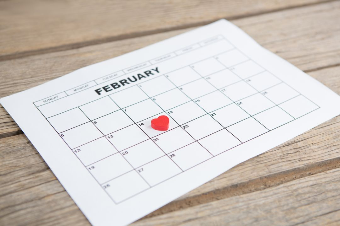 Red heart shape placed on 14th february date of the calendar on wooden background Free Stock Images from PikWizard