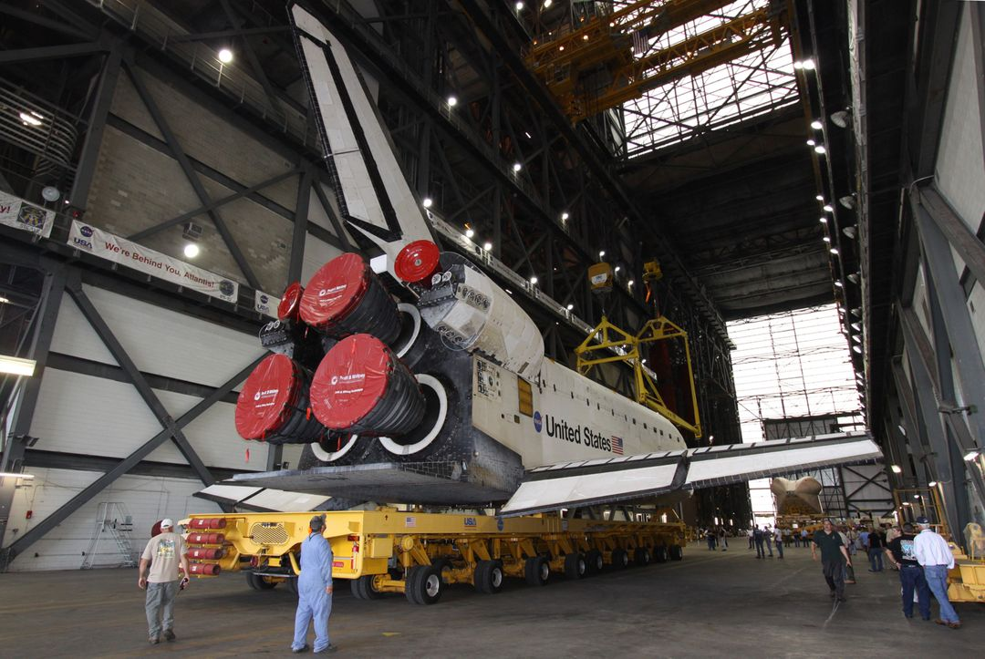 CAPE CANAVERAL, Fla. – At NASA's Kennedy Space Center in Florida, space shuttle Atlantis has arrived in the transfer aisle of the Vehicle Assembly Building for the next phase of its launch preparations.    The rollover from its hangar, Orbiter Processing Facility 1, began about 7 a.m. EDT and was complete at 8:25 a.m. when Atlantis was towed into the VAB's transfer aisle.  Next, Atlantis will be lifted over a transom and lowered into the VAB's high bay 1, where it will be attached to its external fuel tank and solid rocket boosters. Rollout of the shuttle stack to Kennedy's Launch Pad 39A, a significant milestone in launch processing activities, is planned for Oct. 13.  Liftoff of Atlantis on its STS-129 mission to the International Space Station is targeted for 4:04 p.m. EST during a 10-minute launch window on Nov. 12.  For information on the STS-129 mission and crew, visit http://www.nasa.gov/mission_pages/shuttle/shuttlemissions/sts129/index.html. Photo credit: NASA/Jack Pfaller