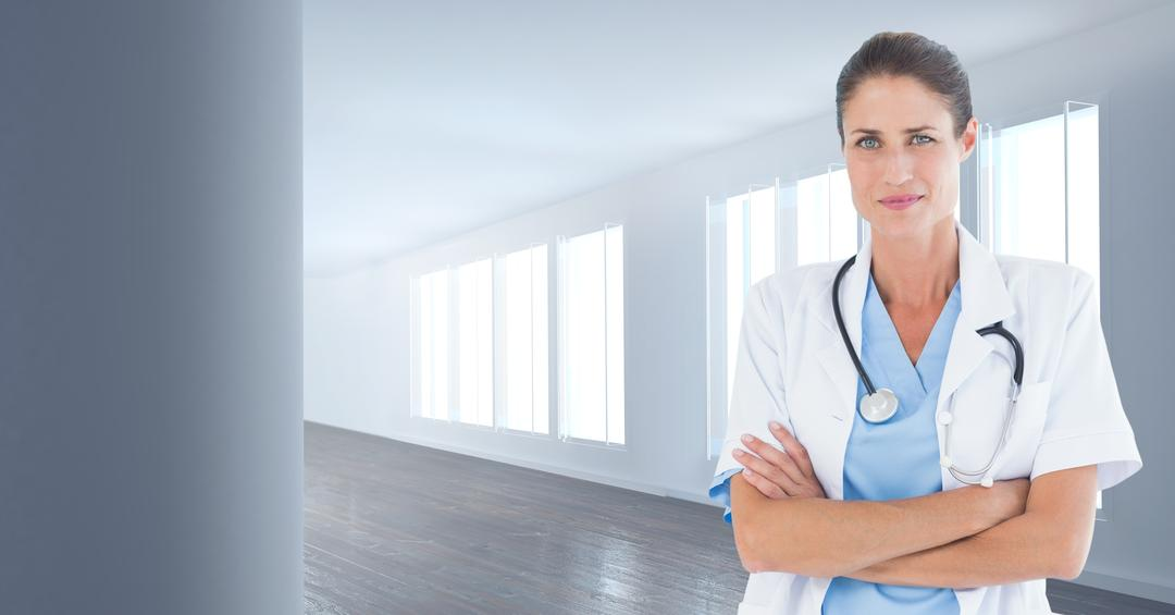 Portrait of female doctor standing with her arms crossed in hospital Free Stock Images from PikWizard