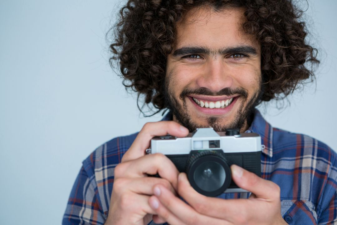 Portrait of male photographer with old fashioned camera in studio Free Stock Images from PikWizard